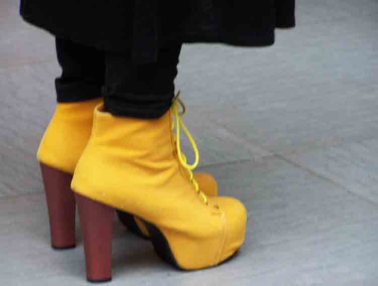 laced yellow shoes with high wooden heels